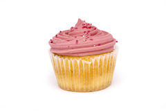 Pink cupcake over white. Pink cupcake on a white background Stock Photo