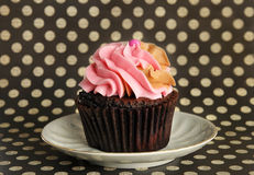 Pink Cupcake on plate Stock Images
