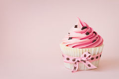 Pink cupcake. With space for copy Stock Photos