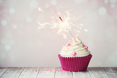 Pink cupcake with sparkler Royalty Free Stock Images