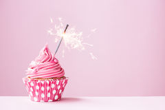 Pink cupcake with sparkler Stock Images