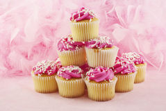 Pink Cupcakes. Delicious cupcakes with pink frosting and sprinkles on a pink background with copy space Royalty Free Stock Photo