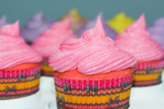 Pink cupcakes with other colors in the background Stock Photo