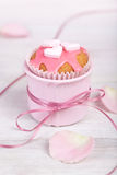 Pink cupcakes in pink cup with satin ribbon and heart shaped decorations Royalty Free Stock Photo