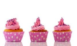 Pink cupcakes with purple sprinkles Royalty Free Stock Photos
