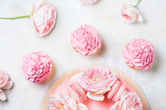 Pink cupcakes with roses and holiday cake. Festive and bright. Wedding Celebration concept. Royalty Free Stock Photos