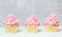 Pink cupcakes with roses and holiday cake. Festive and bright. Wedding Celebration concept. Stock Image