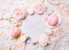 Pink cupcakes with roses and holiday decor in frame. Festive and bright. Wedding Celebration concept. Copy space. Stock Photos