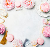 Pink cupcakes with roses and holiday decor in frame. Festive and bright. Wedding Celebration concept. Copy space. Royalty Free Stock Images