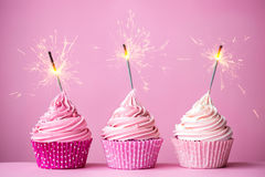 Pink cupcakes with sparklers Royalty Free Stock Photo