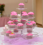 Pink cupcakes on a stand. Pink cupcakes on a cupcake stand Royalty Free Stock Photo