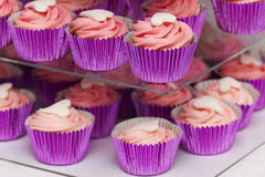 Pink cupcakes on stand Royalty Free Stock Photography