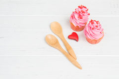 Pink cupcakes for two. Romantic dessert Valentine`s Day Royalty Free Stock Photography