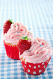 Pink cupcakes on a vintage blue retro towel Royalty Free Stock Photo