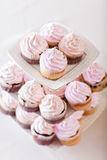 Pink cupcakes at white table Stock Photography