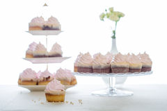 Pink cupcakes at white table Royalty Free Stock Image