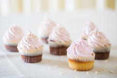 Pink cupcakes at white table Stock Image