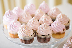 Pink cupcakes at white table Royalty Free Stock Photo