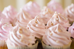 Pink cupcakes at white table Royalty Free Stock Images