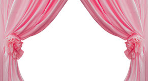 Pink curtain collected in folds ribbon  on a white background Stock Photos