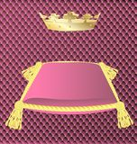 Pink cushion with a crown. Against the background of a pink trim a large pink pillow with gold tassels and a gold crown Stock Photos