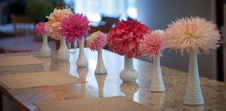 Pink dahlia flowers in vases Stock Photo