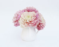 Pink dahlias in white jug on light background. Pink dahlias in white jug on a light background Stock Image