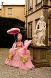 Pink damsel at Lucca Comics and Games 2017. A woman with a 1600 damsel gown during the Lucca Comics and Games 2017 festival Stock Photography