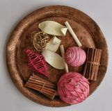 Pink decor. Many pink decorative stuff on ancient copper plate Royalty Free Stock Photo