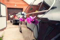 Pink decoration of black wedding car Royalty Free Stock Photos