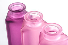 Pink Decorative Bottles. On a white background Stock Image