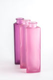 Pink Decorative Bottles. On a white background Royalty Free Stock Photos