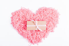 Pink decorative heart and a box with a gift and a ribbon on a wh Royalty Free Stock Photos