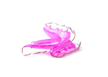 Pink dental retainer orthodontia, isolated on white background Royalty Free Stock Photography