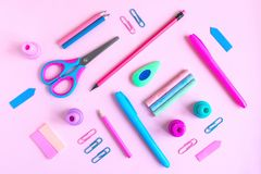 Pink desk with variety of rose and blue school supplies. Back to royalty free stock photo