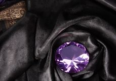 Pink diamond in the black fabric Royalty Free Stock Photography