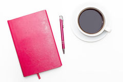 Pink diary with pen and a Cup of black coffee on white background. Stock Image