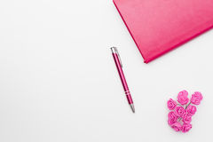 Pink diary pen roses on a white background Royalty Free Stock Image