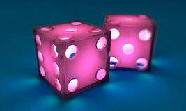 Pink dice. On blue background, illuminated from within Stock Photo