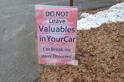 Pink do not leave valuables in your car theft has occurred sign. Pink do not leave valuables in your automobile theft has occurred sign royalty free stock photo