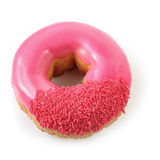 Pink Donut. Pink iced donut with sprinkles, isolated on white with shadow Royalty Free Stock Photo