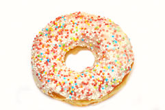Pink donut with candy. On white background Stock Photography