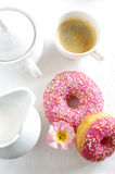 Pink donut and coffee Royalty Free Stock Image