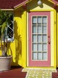 Pink door. Bright yellow and pink doorway Stock Photo