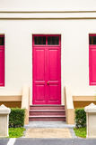pink Door , pink window on Cream Wall on pink staircase with sma Stock Image