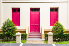 pink Door , pink window on Cream Wall on pink staircase with sma Royalty Free Stock Image