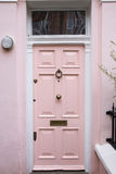 Pink door in typical London house Royalty Free Stock Photo