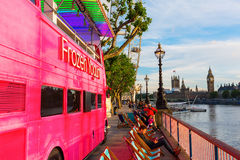 Pink double decker bus in London, UK Stock Photo