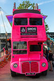 Pink double decker bus in London, UK Stock Images