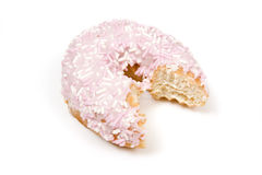 Pink doughnut with bite mark. Decorative pink ring doughnut with bite mark, isolated on white background royalty free stock photo